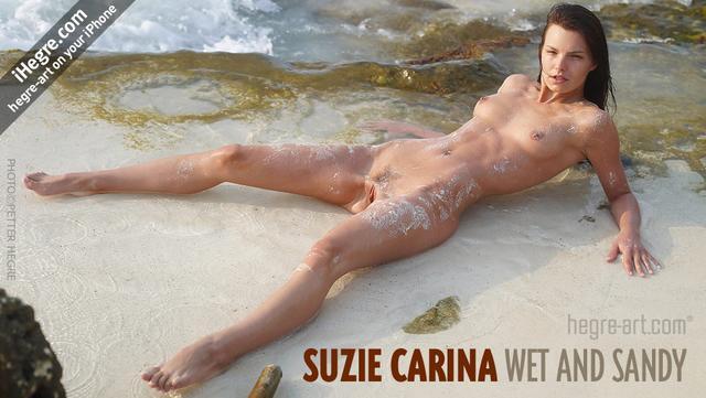Suzie Carina wet and sandy